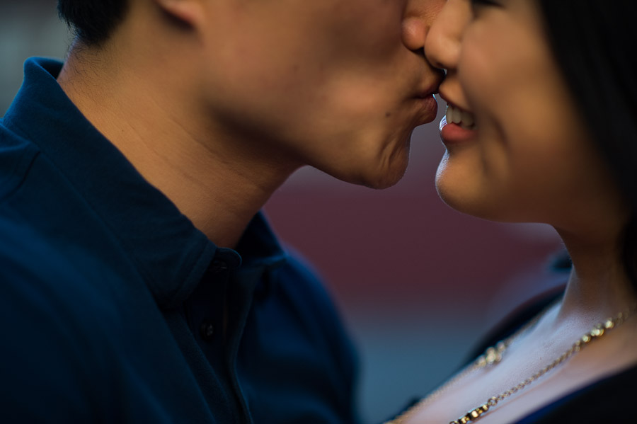 And up-close view while a man kisses a smiling woman during their Pioneer Square engagement session