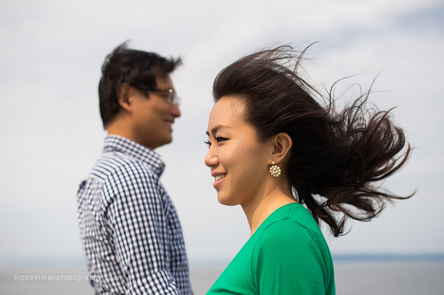 A windblown couple pose on a Washington State ferry between Edmonds and Kingston in Puget Sound