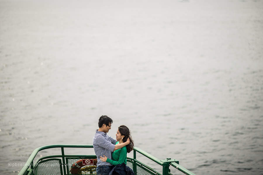A couple in love over Puget Sound on a Washington State ferry between Edmonds and Kingston